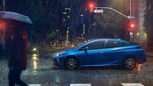 Toyota Prius in the rain, under stop light